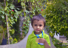 Kid showing medal Stock Photo
