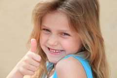 Kid showing ok. Cute little girl showing ok sign Royalty Free Stock Photography