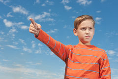 Kid showing right direction Stock Photos