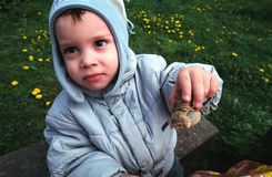 Kid showing snail Royalty Free Stock Image