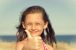 Kid showing thumb Royalty Free Stock Image