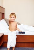 Kid showing thumb up in hotel room after bathing Stock Photography