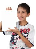 Kid showing white blank paper sign space Royalty Free Stock Images