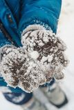 Kid showing winter gloves with snow. Kid showing winter gloves with a snow Stock Image