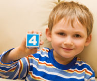 Kid shows figure four Stock Photos