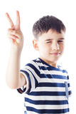 Kid shows victory sign Stock Photo