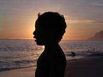 Kid in silhouette Stock Image