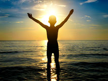 Kid Silhouette in the Sea Stock Photography