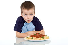 Kid sipping up pasta Royalty Free Stock Images
