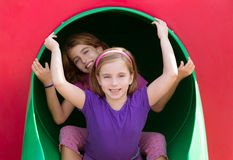 Kid sister girls playing in the park playground royalty free stock photo