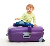 Kid sit on the big suitcase Stock Photography