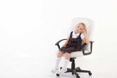 Kid sit on chair and thinking Stock Photos