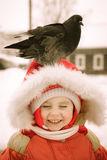 The kid sits on his head dove. Royalty Free Stock Images