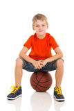 Kid sitting basketball Stock Photo
