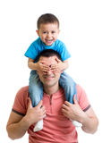 Kid sitting on dad shoulders isolated on white. Background royalty free stock photos