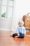 Kid sitting on floor Stock Photo