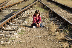 Kid sitting on ground Royalty Free Stock Photography