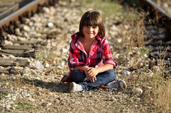Kid sitting on ground Stock Photography
