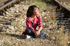 Kid sitting on ground royalty free stock images
