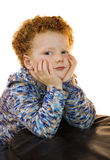 Kid sitting with head in his hands Stock Photography