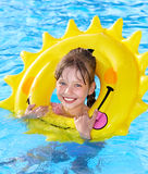 Kid sitting on inflatable ring. Royalty Free Stock Image