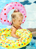 Kid sitting on inflatable ring. Stock Photos