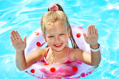 Kid sitting on inflatable ring. Stock Images