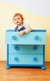 Kid sitting inside box Stock Photos