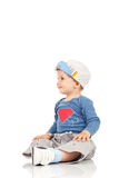 Kid sitting and looking a side Royalty Free Stock Image