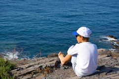 Child looking to the sea royalty free stock photo