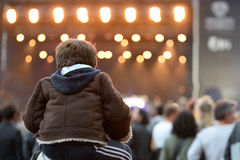 A kid sitting on the shoulders of his father at Heineken Primavera Sound 2014 Stock Photography