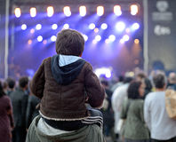 A kid sitting on the shoulders of his father at Heineken Primavera Sound 2014 Festival Stock Photography