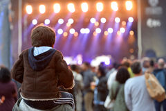 A kid sitting on the shoulders of his father at Heineken Primavera Sound 2014 Festival Royalty Free Stock Photos