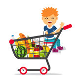 Kid sitting in a supermarket shopping cart Stock Photography
