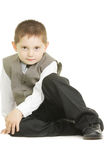 Kid sitting on white ground Stock Images