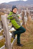 Kid sitting on wooden fence Royalty Free Stock Photo