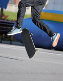 Skater. Close up view of a skater jumping on skateboard royalty free stock photo