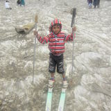 Kid skates on ice. A boy skates on ice pic of sonmarg kashmir Royalty Free Stock Photography