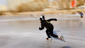 A kid skating. A little boy was skating on a river in Jinzhou, northeast China Royalty Free Stock Photos