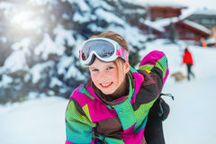 Kid in ski outfit and goggles. Happy kid in ski outfit and goggles at the ski resort Royalty Free Stock Photos