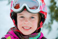Kid in ski outfit, helmet and goggles. Portrait of a kid in ski outfit, helmet and goggles Stock Image