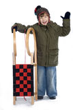 Kid with sled. Young boy with sled posing over white background Royalty Free Stock Images