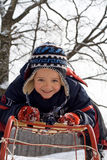 Kid on a sledge Stock Photos