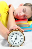 Kid sleep with Alarm Clock Stock Photo