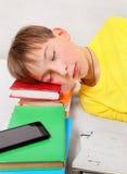 Kid sleep on the Books Stock Photo