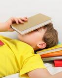 Kid sleep with a Books Stock Image