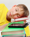 Kid sleep with a Books. Tired Kid sleep with the Books on the Bed Royalty Free Stock Photo