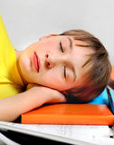 Kid sleep with a Books Royalty Free Stock Photography