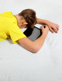 Kid sleep with Tablet Computer Royalty Free Stock Photos