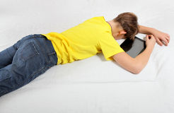 Kid sleep with Tablet Computer Royalty Free Stock Photography